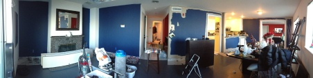 Before: Flat Dark blue dining room and entry way.